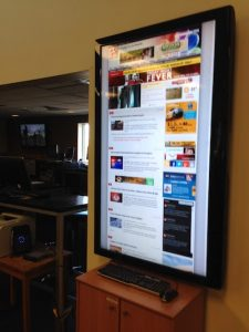 A large digital display of the website is viewable at all times from the newsroom of the hybrid student and professional organization, KOMU at the University of Missouri-Columbia