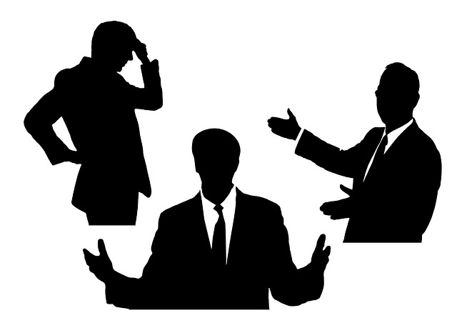 People silhouetted in different poses: thinking, explaining, questioning.