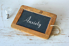 "chalkboard with ""anxiety"" written on it"