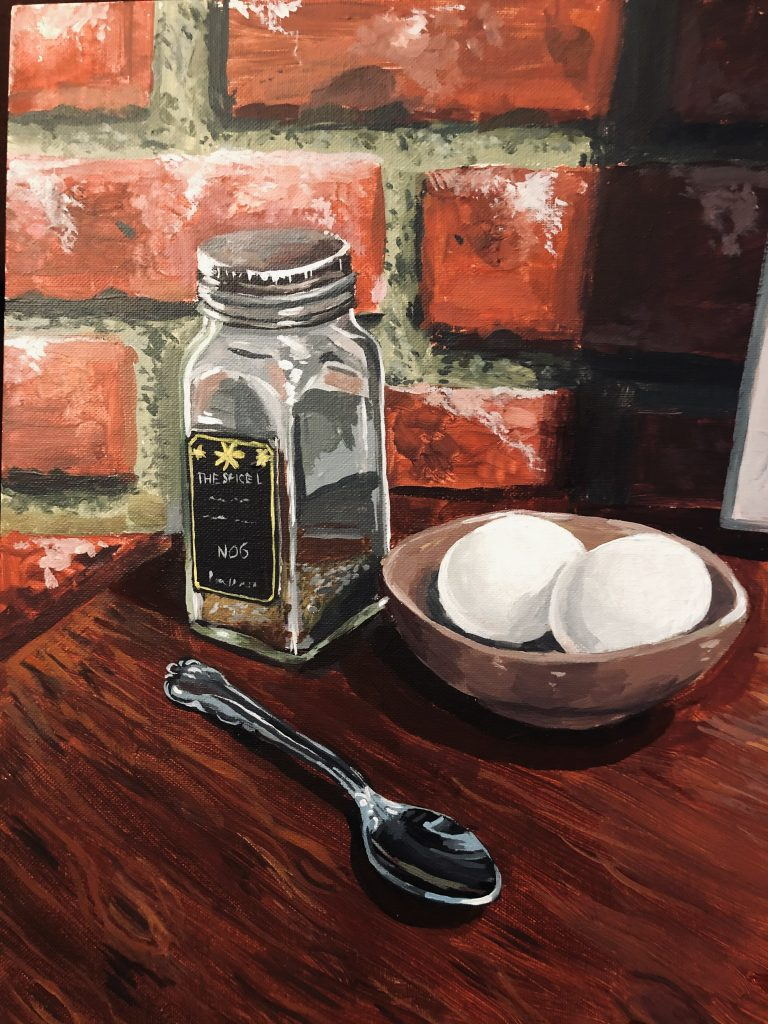 Hard boiled eggs and salt shaker on a counter in a kitchen